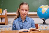 Schoolgirl reading a book — Stock Photo