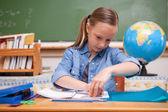 Schoolgirl doing classwork — Stock Photo