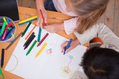 Above view of little schoolgirls drawing — Stock Photo