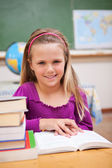 Portrait of young schoolgirl reading a book — Stock Photo