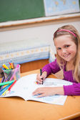 Portrait of a schoolgirl drawing — Stock Photo