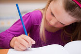 Close up of a schoolgirl writing — Stock Photo