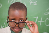 Schoolboy looking over his glasses — Stock Photo
