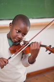 Portrait of a schoolboy playing the violin — Stock Photo