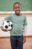 Portrait of boy holding a ball — Foto Stock