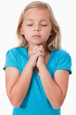 Portrait of a young girl praying — Stock Photo
