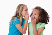 Young girl whispering a secret to her friend — Stock Photo