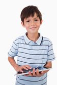 Portrait of a cute little boy using a tablet computer — Stock Photo