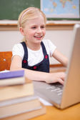 Portrait of a girl using a laptop — Stock Photo