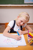 Portrait of a girl drawing — Stock Photo