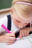 Portrait of a focused girl drawing — Stock Photo