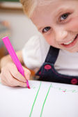Portrait of a cute girl drawing — Stock Photo