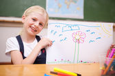 Smiling girl showing her drawing — Stock Photo
