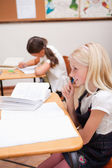 Portrait of pupils doing classwork — Stock Photo