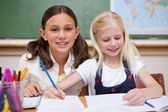 Pupils working together on an assignment — Stock Photo