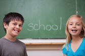 Happy pupils posing together — Stock Photo