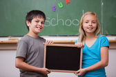 Pupils holding a school slate — Stock Photo