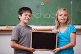 Pupils holding a school slate — Stock Photo