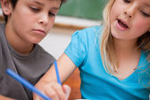 Close up of two children writing — Stock Photo
