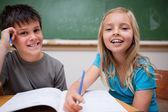 Two children writing — Stock Photo