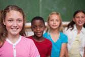 Classmates posing in a row — Stock Photo