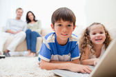 Cute kids playing computer games on laptop — Stock Photo