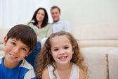 Family sitting in the living room — Stock Photo