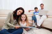 Family spending leisure time in the living room — Stock Photo