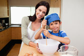 Mother and son having fun preparing dough — Stock Photo