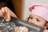 Girl stealing a cookie — Stock Photo