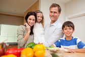 Family standing in the kitchen — Stock Photo