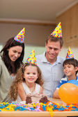 Family celebrating daughters birthday — Stock Photo