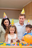 Happy family celebrating daughters birthday — Stock Photo
