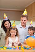 Happy family celebrating daughters birthday — Stock Photo