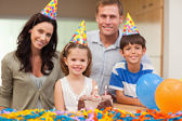 Smiling family celebrating daughters birthday — Stock Photo