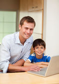 Father and son with notebook — Stock Photo