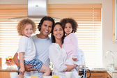 Family having breakfast in the kitchen — Stock Photo