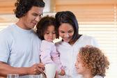 Family enjoys having breakfast together — Stock Photo