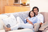 Happy couple on the couch together — Stock Photo