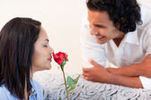 Man just gave his girlfriend a rose — Stock Photo