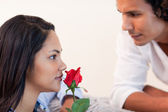 Male just gave his girlfriend a rose — Stock Photo