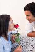 Woman got a rose from her boyfriend for valentines day — Stock Photo