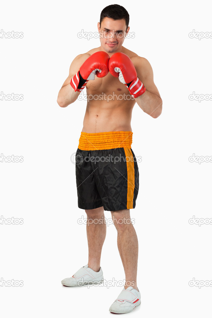 Confident looking boxer against a white background — Stock Photo #11200428