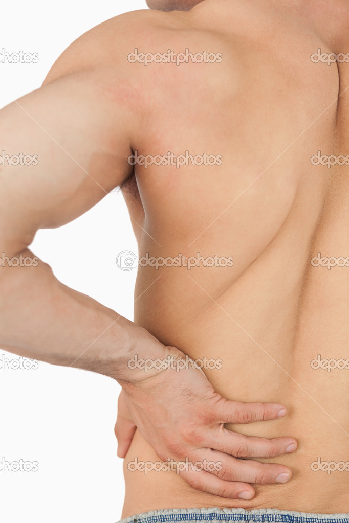 Young male having back pain against a white background — Stock Photo #11200775