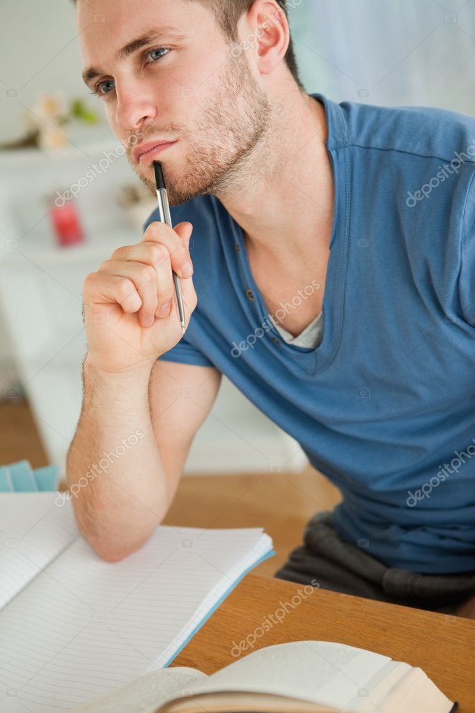 Young male student doing his homework — Stock Photo #11201853