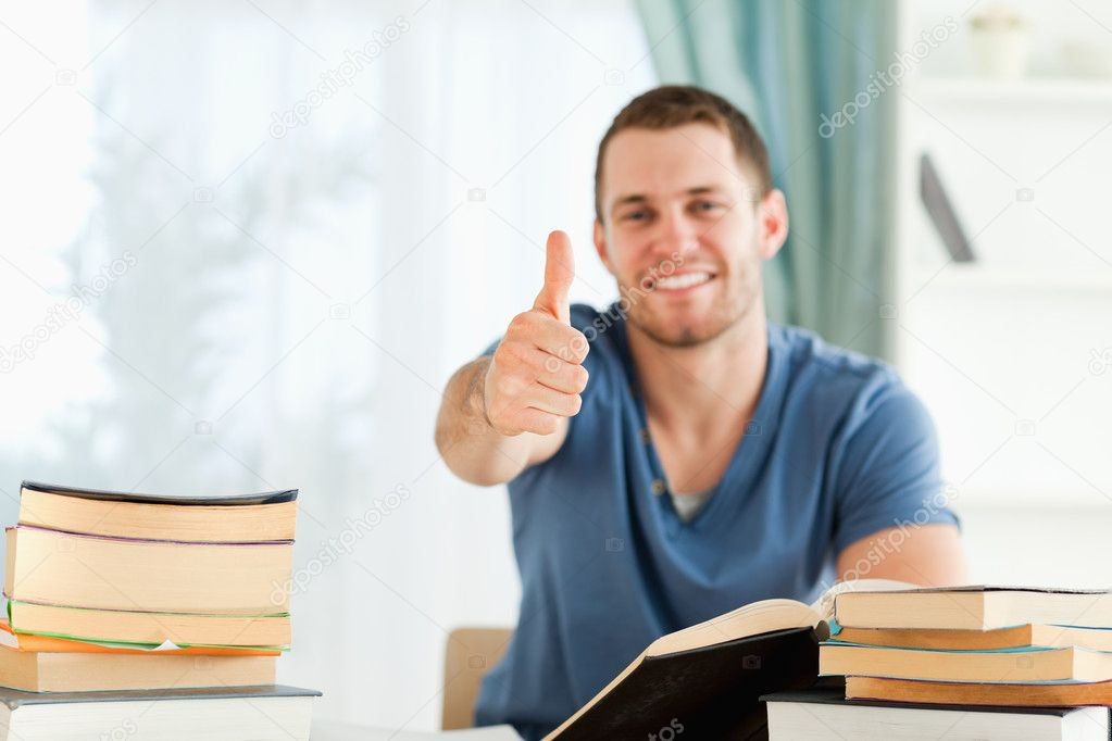 Male student finished his book report — Stock Photo #11201856