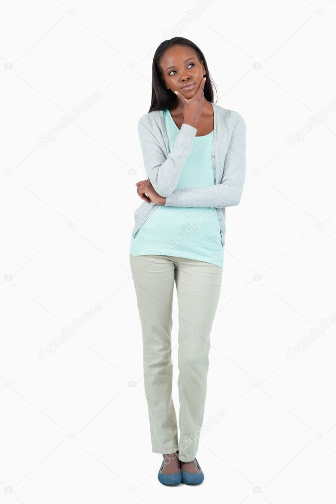Young woman lost in her thoughts against a white background  Stock Photo #11201976