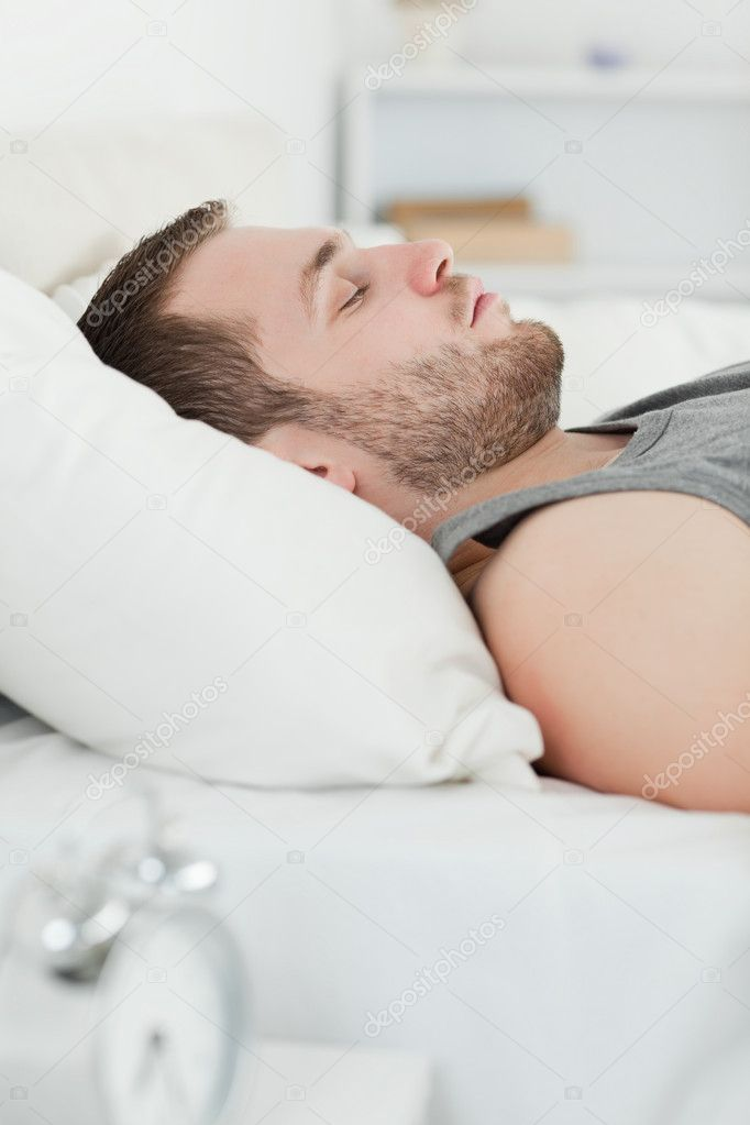 Portrait of a quiet man sleeping in his bedroom  Stock Photo #11203344
