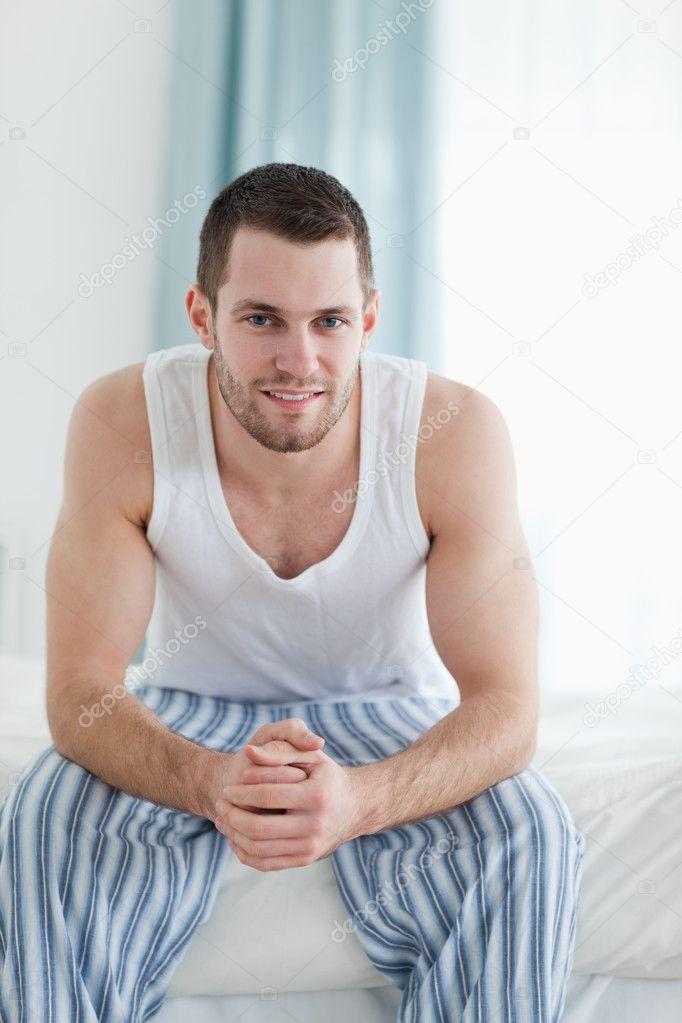 portrait dun homme tranquille assis sur son lit photographie wavebreakmedia 11203742. Black Bedroom Furniture Sets. Home Design Ideas