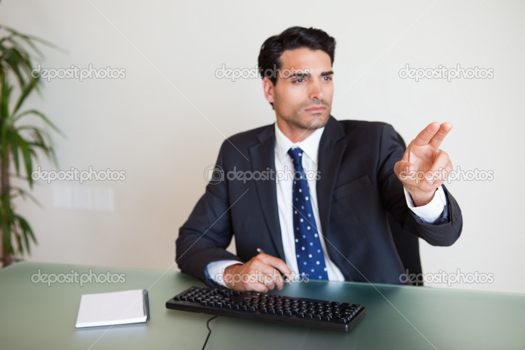 Businessman showing something in his office — Stock Photo #11206681